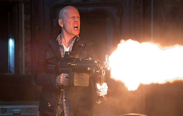Bruce Willis fires a weapon in Die Hard