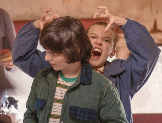 behind the scenes stranger things eleven mike child actor on set